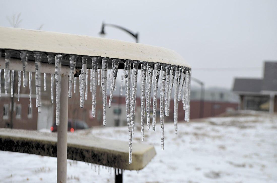 -Messenger photo by Peter Kaspari  Icicles hang from a picnic table outside the Webster County Social Services Building Monday morning.