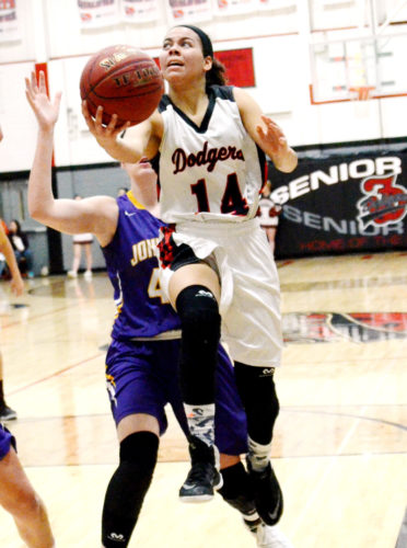 Messenger photo by Britt Kudla  Justice Crooks of Fort Dodge goes up for a shot against Johnston last Friday in the Dodger gym.