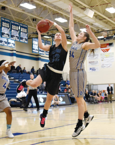-Messenger photo by Britt Kudla Michaela Graffunder of Iowa Central shoots around DMACC's Samantha Hughes on Wednesday