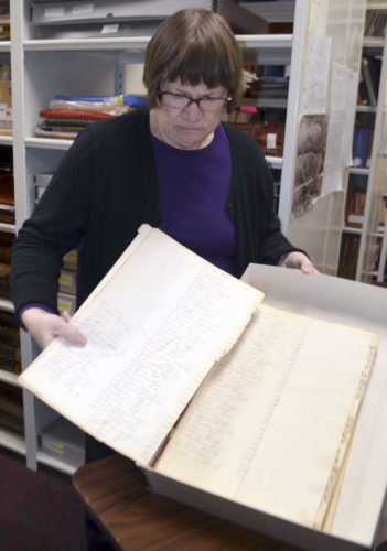 -Messenger photo by Chad Thompson Susan Olson, a member of the Webster County Genealogical Society, shows how delicate certain documents stored at the Fort Dodge Public Library can be. To help preserve them, the society would like to buy a special scanner. Susan Olson, a member of the Webster County Genealogical Society, shows how delicate certain documents can be Wednesday morning at the Fort Dodge Public Library.