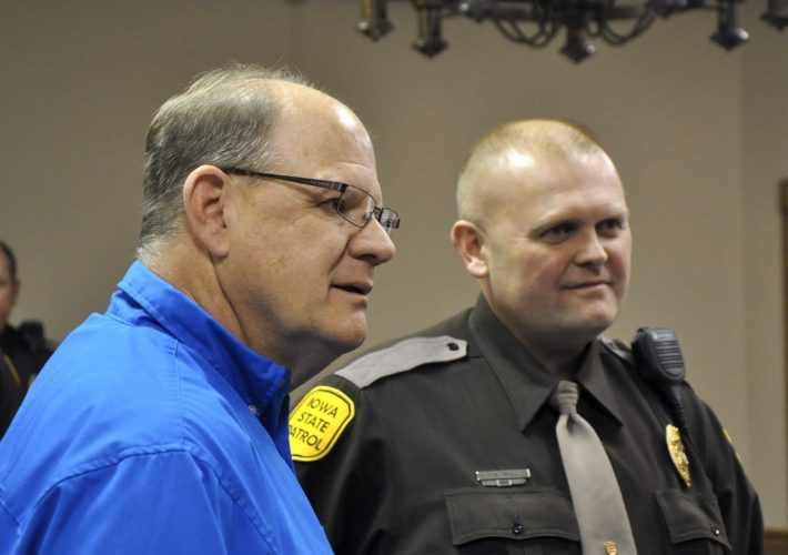 -Messenger photo by Peter Kaspari  Kelly Hindman, left, a retired lieutenant with the Iowa State Patrol's District 7, stands next to Trooper Kevin Krull, of District 6, Thursday. Hindman had a retirement party at the Best Western Starlite Village Inn & Suites honoring his 28 years with the Iowa State Patrol. Hindman retired in November.