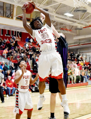 Messenger photo by Britt Kudla  Silas Naylor of Fort Dodge rebounds against Johnston earlier this month inside the Dodger gym.