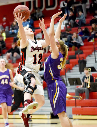 Messenger photo by Britt Kudla  Maggie Harvey of Fort Dodge shoots in the Dodger gym earlier this month.