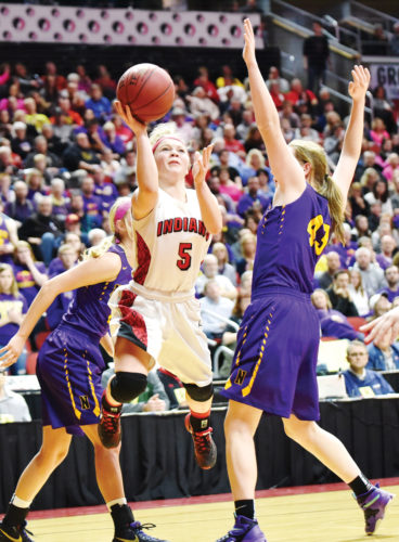 Messenger photo by Britt Kudla  Elle Ruffridge of Pocahontas Area shoots around Nevada's Hattie Rhodes during the 3A state championship game last season.
