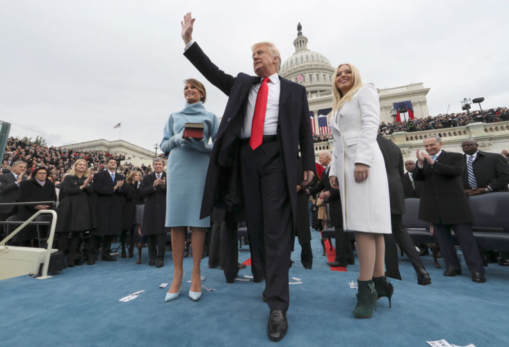 -AP photo  President Donald Trump waves after taking the oath of office from Chief Justice John Roberts, as his wife Melania holds the Bible, daughter Tiffany stands beside him, Friday, on Capitol Hill in Washington.