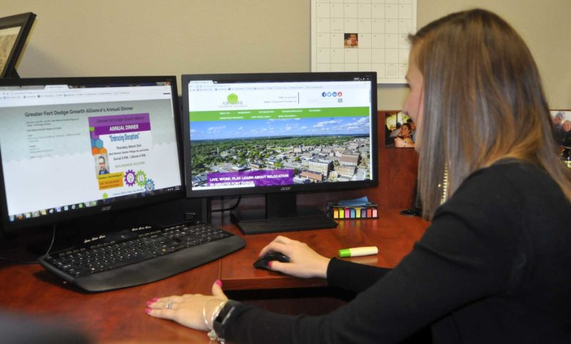 -Messenger photo by Chad Thompson  Kate Stucky, office manager at the Greater Fort Dodge Growth Alliance, shows off the new website Friday afternoon in her office.