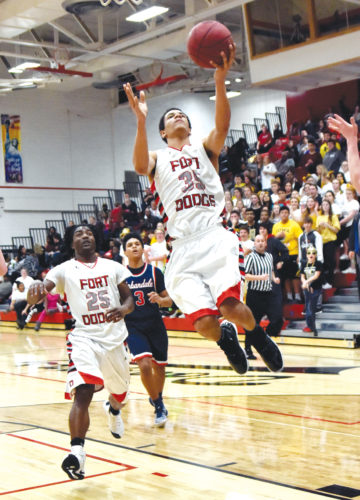 -Messenger photo by Britt Kudla Solomon Clayton of Fort Dodge goes up for a shot against Urbandale on Friday