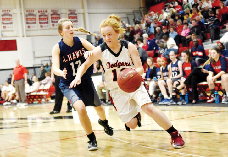 -Messenger photo by Britt Kudla Maggie Harvey of Fort Dodge drives towards the basket against Urbandale on Friday
