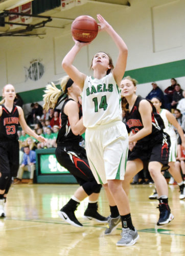 -Messenger photo by Britt Kudla Jacque Oberg of St. Edmond puts up a shot against Hampton-Dumont on Friday