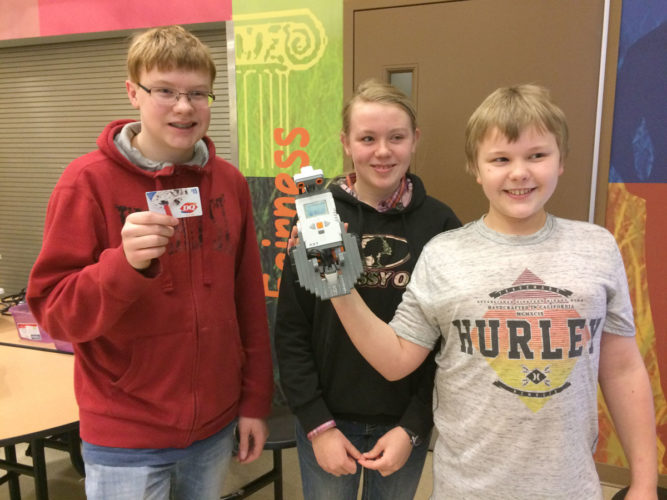 Glenn Small, Greta Small and Graham Small display their competition winning robot and their prize award for Dairy Queen.