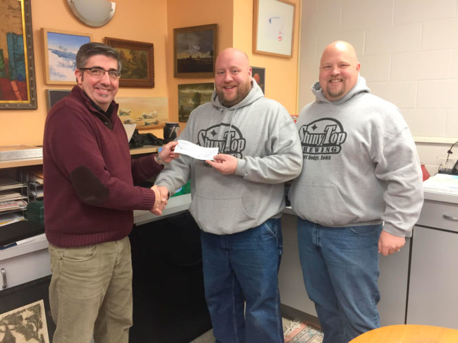 Shiny Top Brewing presented the Blanden Memorial Art Museum with a check for $550 from its recent Savage Stout program. Shiny Top's brew Savage Stout is named after painter, Thomas Savage, a Fort Dodge native. In addition to being a full-time farmer, Savage had pursued studies at the Layton Art School in Milwaukee, Wisconsin. Pictured are Blanden Director Eric Anderson, Nate McCubbin and Todd McCubbin, Shiny Top Brewing.