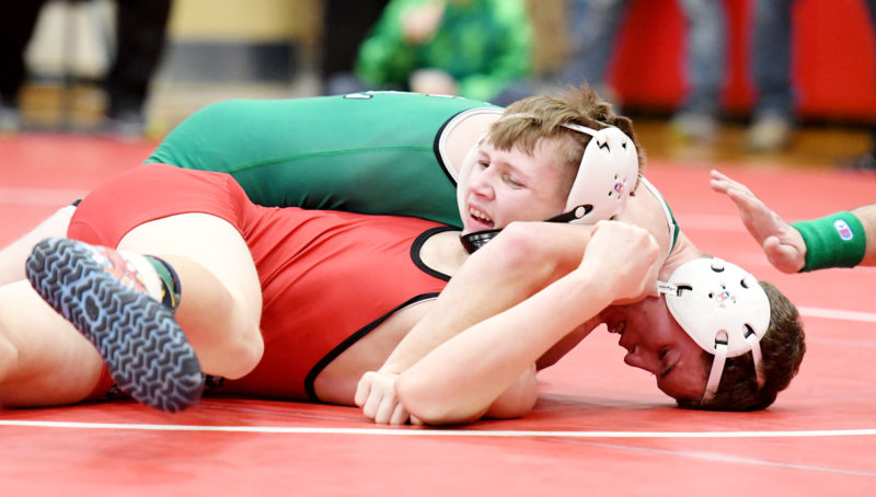 Photo by Troy Banning, for The Messenger  Connor Allison of St. Edmond records a pin in the 132-pound semifinals on Saturday at the NCC wrestling meet in Algona.
