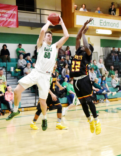 Messenger photo by Britt Kudla  Will Woodruff of St. Edmond drives against Iowa Falls-Alden's Tyjon Rose on Saturday.