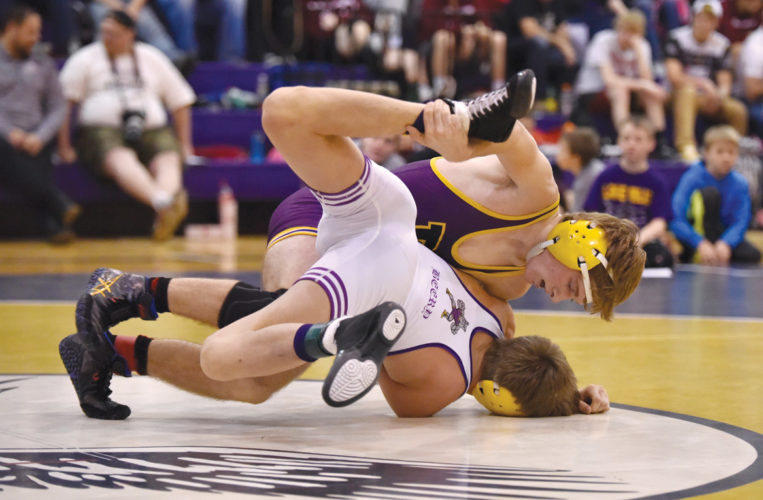 -Messenger photo by Britt Kudla Derek Graham of Eagle Grove wrestles against Lake Mills Kyle Beery during Class 1A Sectionals on Satuday