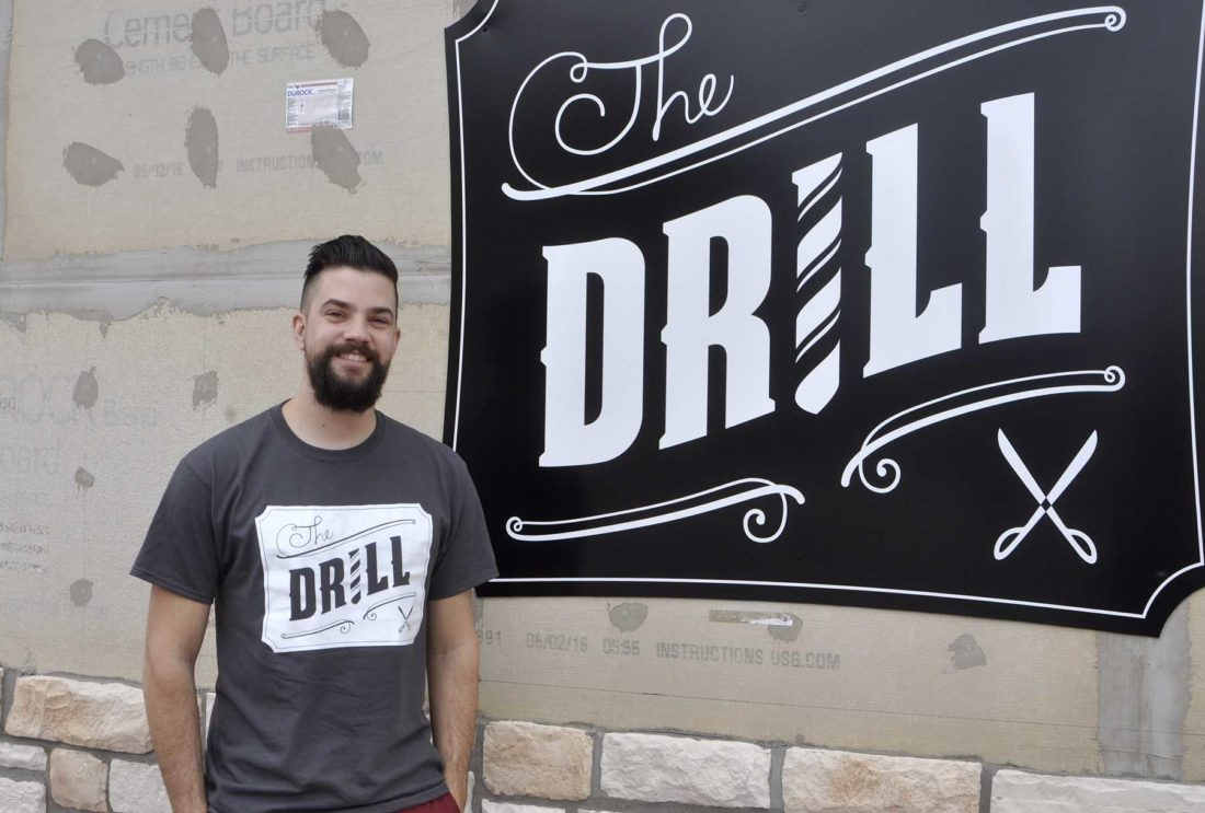 -Messenger photo by Chad Thompson  Phil DeCastro, owner of The Drill Barbershop, stands outside of his Fort Dodge shop, located at 1302 Central Ave. No. 100, recently.