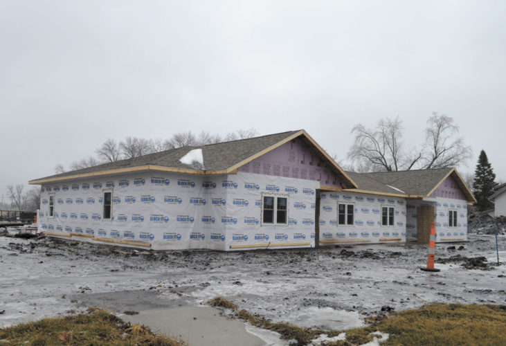 Messenger photo by Chad Thompson  Torkelson Construction, of Eagle Grove, is working on a fourplex at the corner of Northeast Second Street and Jackson Avenue in Eagle Grove as part of the Commercial Construction Incentive Program.