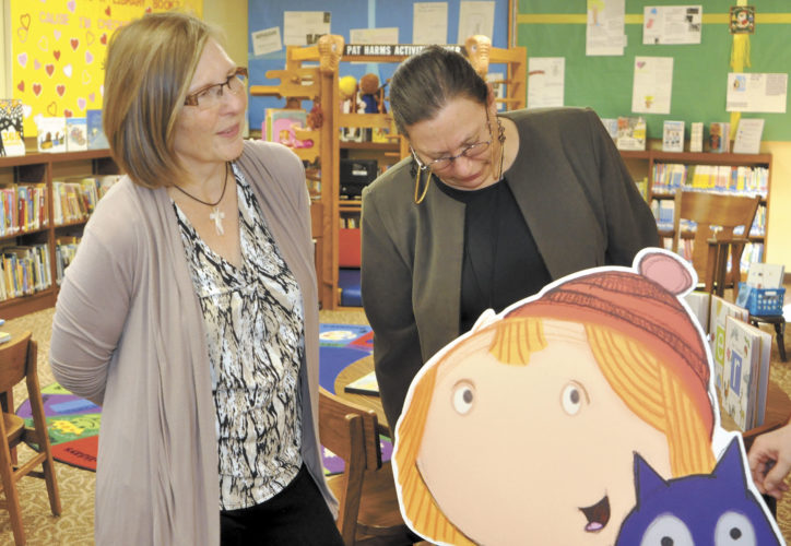 -Messenger photo by Peter Kaspari  Laurens Public Library Director Glenda Mulder, left, and Children's Librarian Jeri Wenell, look over a recently refurbished area of the library that was created thanks to a partnership with Iowa Public Television. Mulder said IPTV provided books and DVDs for early childhood literacy.