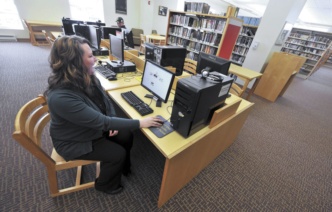 -Messenger photo by Hans Madsen  Rockwell City library director Denise Pohl checks out one of the computers in her library recently. They were recently able to upgrade their internet service to a fiber optic system.