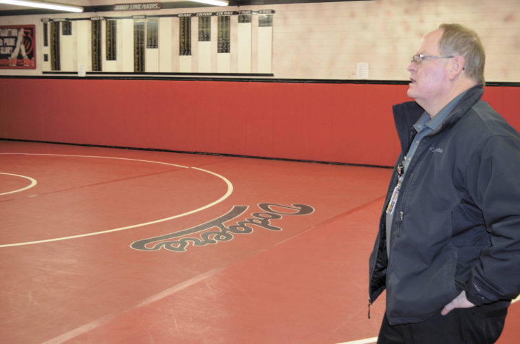-Messenger photo by Chad Thompson  Travis Filloon, Fort Dodge Community School District director of buildings and grounds, explains the importance of climate control for wrestling practice rooms Monday afternoon inside the current Fort Dodge Senior High wrestling room. As part of the $27 million bond issue that was passed about a year ago, the old wrestling room will be replaced.