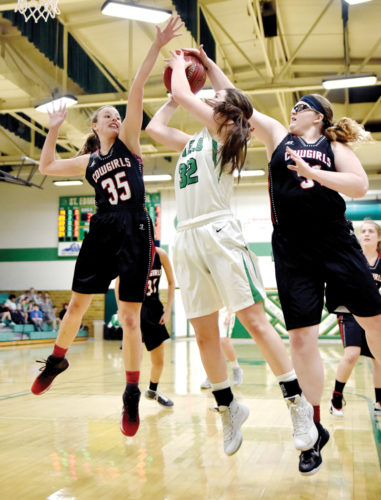 -Messenger photo by Britt Kudla Clarion-Goldfield's Vanessa Kolb (35) and Hannah Terhark (51) blocks St. Edmond Erin Flattery shot on Monday