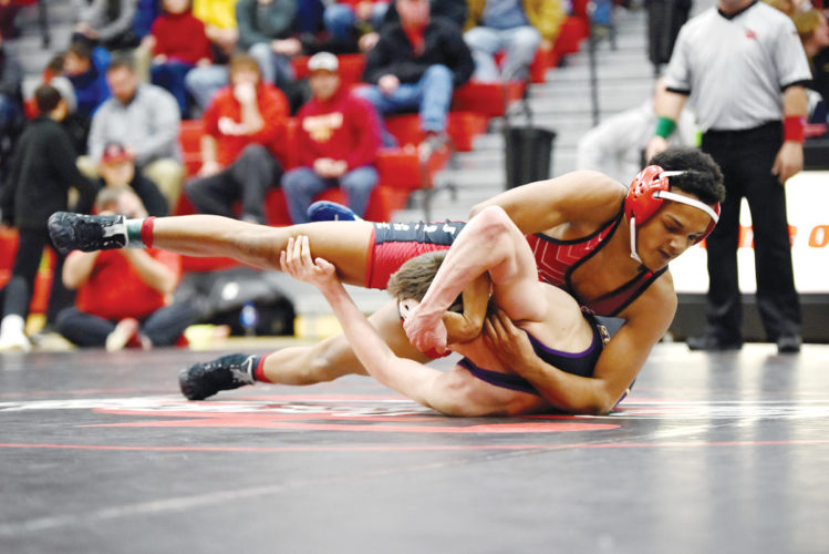 Messenger photo by Britt Kudla  Drevon Ross of Fort Dodge pins Waukee's Sam Bloch in a regional dual on Wednesday in the Dodger gym. For more photos, please visit CU.messengernews.net