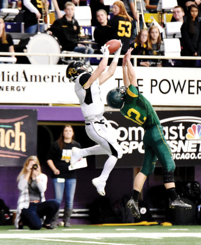 Messenger photo by Britt Kudla  Gibson Behr of Bishop Garrigan makes a catch at the UNI-Dome. Behr has signed with the Iowa Central football team.