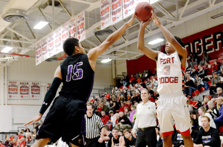 Messenger photo by Britt Kudla Trey Mosley of Fort Dodge shoots against Johnston earlier this season.
