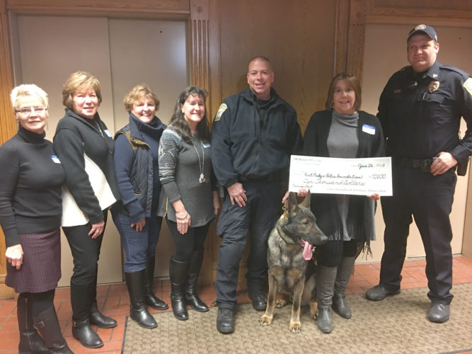 The 100+ Women Who Care recently presented a check for $10,200 to the Fort Dodge Police Foundation K-9 Unit to be used for equipment needed to utilize the services of the new dogs in the department. Pictured left are Teeny Kamrath, Sondra Holmstrom, Carole Stitt, Kim Shimkat, Patrol Officer Paul Samuelson, Abram, Rhonda Nelson, and Sgt. Steve Hanson.