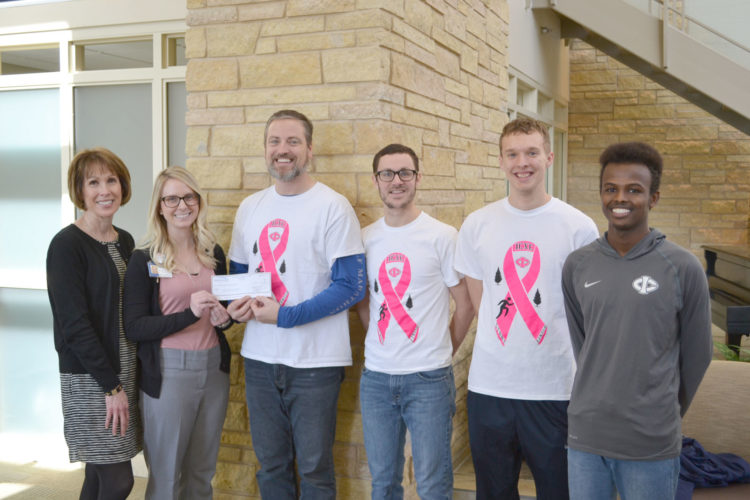 "The Iowa Central Cross Country team presented a check for $2,000 to the UnityPoint Health — Fort Dodge Cancer Center. Funds were raised in the annual ""Race to Erase"" Breast Cancer Fundraiser. Since 2007 the team has raised $15,500 for this cause. Pictured from left are Carol Grannon, Director of Major Gifts, Trinity Foundation; Christen Sewell, manager, Trinity Cancer Center; head  cross country coach Dee Brown, assistant cross country coach Jeremiah Feine, Ben Thompson and Abdinasir Abdi."