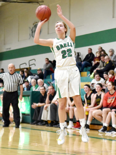 -Messenger photo by Britt Kudla Megan Flattery of St. Edmond puts up a shot against Iowa Falls-Alden on Saturday