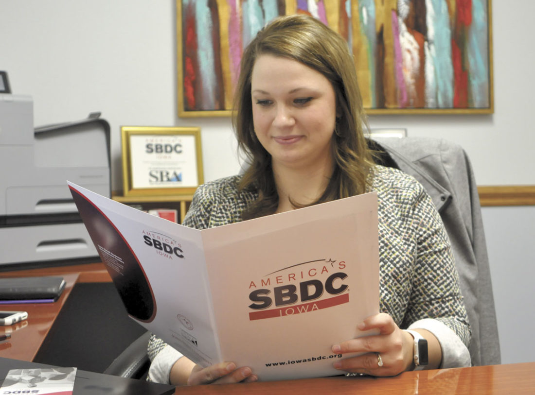 -Messenger photo by Peter Kaspari Stefanie Koenig, regional director of the North Central Iowa Small Business Development Center, looks over a folder of materials in her office. Koenig said the SBDC had a successful year in 2016 and is looking forward to new changes in 2017.
