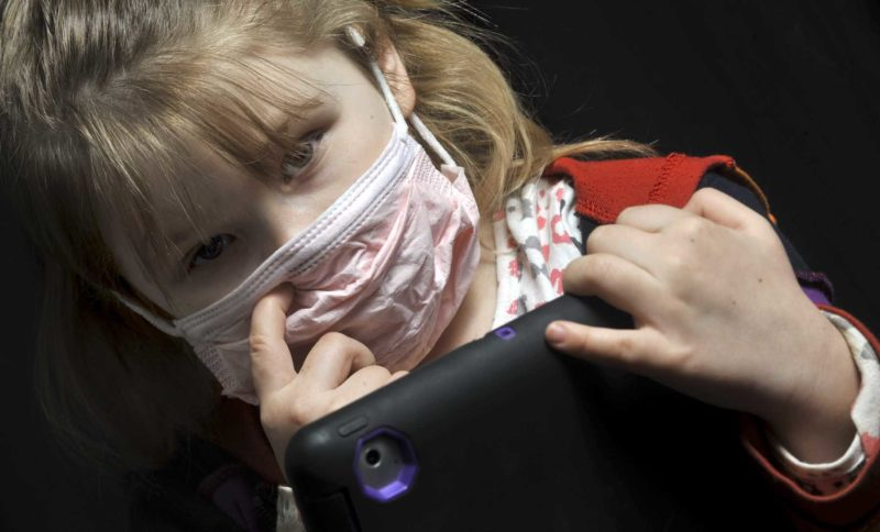 -Messenger photo by Hans Madsen  Amber Dawson, 5, a transitional kindergarten student of Fort Dodge, demonstrates an extreme precautionary measure to deal with the outbreak of flu that's occuring in the area. Manson Northwest Schools are closed today, due to flu, while staff disinfect the buildings.