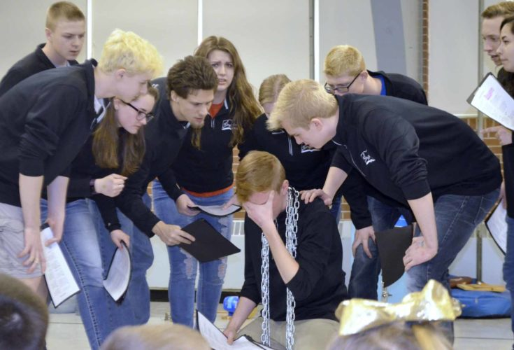 -Messenger photo by Chad Thompson  Collin Ellsbury, 16, breaks under the pressure of being bullied during a FDSH Storytellers performance at Cooper Elementary School Thursday. Each chain represents a mean comment that was said to him.