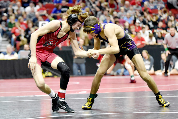 Messenger photo by Britt Kudla  Drew Bennett of Fort Dodge wrestles Waukee's Kyle Biscoglia during Class 3A semifinal action on Friday in Des Moines. For more photos, please visit CU.messengernews.net