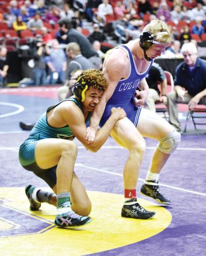 Messenger photo by Britt Kudla  Kyler Fisher of Southeast Valley wrestles against Tucker Morrison on Friday in Des Moines.