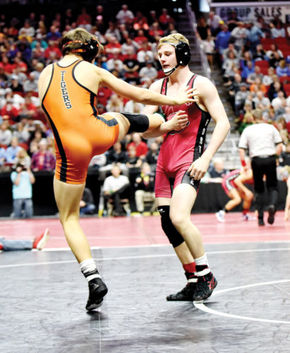 Messenger photo by Britt Kudla  Brody Teske of Fort Dodge wrestles against West Des Moines Noah Hughes-Reilly on Friday in Des Moines.