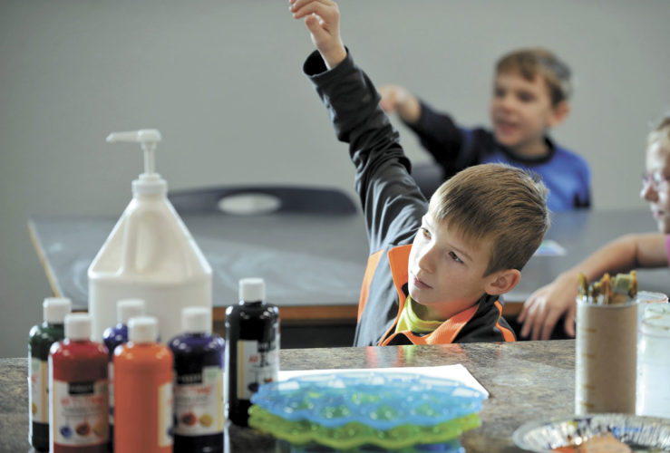 -Messenger photo by Hans Madsen  Surrounded by art supplies, Tyson Nelson, 10, of Fort Dodge, gets ready to answer a question about shade and tint during an art class at Community Christian School. The full-time art program was added to the school's curriculum.