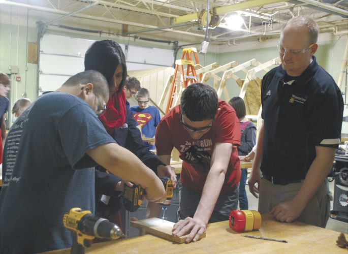 —File photo   Students in Ben Jass' industrial technology class work together with students in Amanda Nichols' special education class to make squirrel feeders during the 2016 fall semester at Webster City High School.