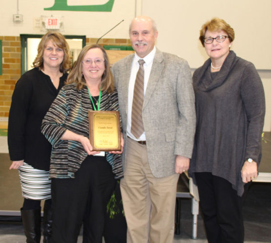 Candis Streit received the 2017 Educare Award at the All School Mass during Catholic Schools Week on Feb. 3.   She is a second-grade teacher at St. Edmond Catholic School. She has been a part of the St. Edmond Catholic School System for 31 years, beginning with teaching middle school at Sacred Heart, then for the last 18 years at St. Edmond.   Streit graduated from St. Edmond with the class of 1972 and is married to Dan Streit. The couple are parents to daughter  Ashley  (Joe) Bohen who also graduated from St. Edmond in the Class of 2010. The purpose of this award is to honor the dedication and valued contribution of all teachers serving in the ministry of Catholic education. The Educare Award for Excellence in Catholic Education is sponsored by the Educare Company and the Kevin and Rebecca McCarville family.  Kevin is a 1970 graduate of St. Edmond.  This is the 13th year this award has been presented by the McCarville family.  Pictured from left are St. Edmond President Mary Gibb,  Streit,  Educare President Kevin McCarville and  St. Edmond Principal Linda Mitchell.