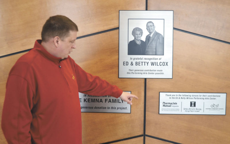 -Messenger photo by Chad Thompson  Jared Cecil, Algona High School principal, points out some of the people and organizations who made the new Ed and Betty Wilcox Performing Arts Center a reality at the school.