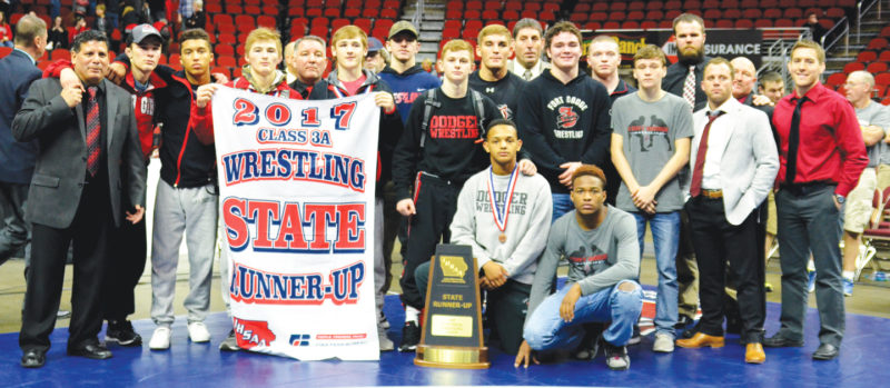 Messenger photo by Britt Kudla  The Fort Dodge wrestling team stands with its state runner-up team trophy on Saturday night in Des Moines.
