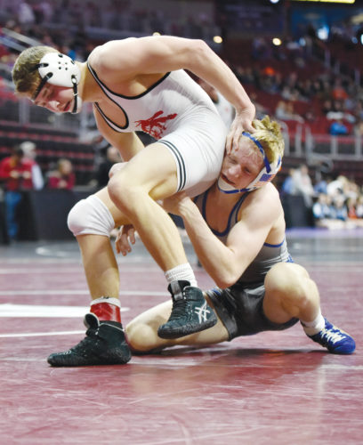 Messenger photo by Britt Kudla  Shea Ruffridge of Pocahontas Area wrestles against Perry's Zachary Thompson during a Class 2A third place consolation final on Saturday inside Wells Fargo Arena.