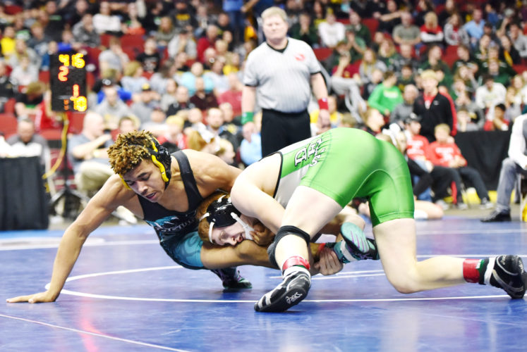 Messenger photo by Britt Kudla  Kyler Fisher of Southeast Valley wrestles against Osage's Brock Jennings during the Class 2A 170-pound championship on Saturday night in Des Moines.