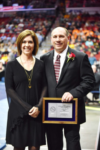 Messenger photo by Britt Kudla  Former Fort Dodge head coach Ed Birnbaum stands with his wife, Susie, after he was inducted into the Iowa Wrestling Hall of Fame on Saturday in Des Moines.
