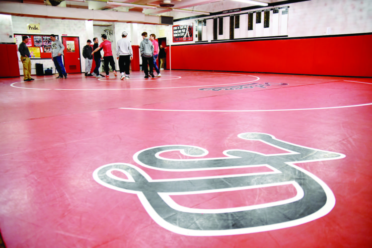 Messenger photo by Britt Kudla  Dodger wrestlers gather together in the school's wrestling room for one of the final times last Sunday at Fort Dodge Senior High.