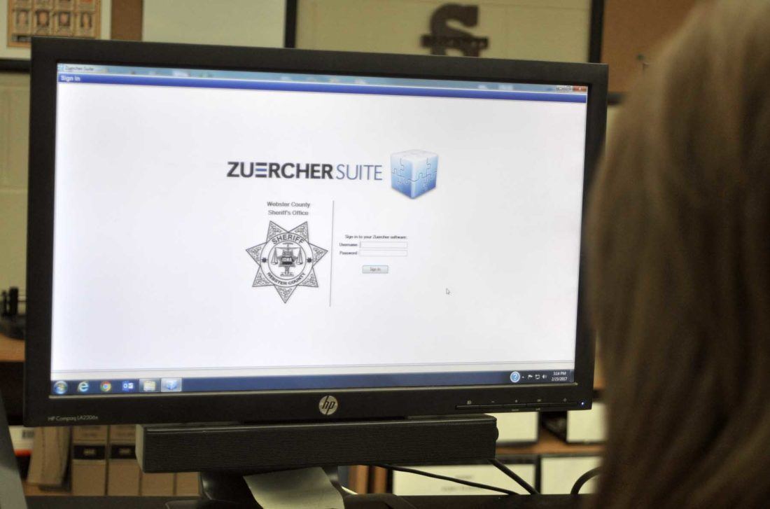 -Messenger photo by Peter Kaspari  Christy Nelson, a civil clerk with the Webster County Sheriff's Department, prepares to log in to Zuercher, software the department recently purchased. Nelson said the software, which is also used in the jail, has helped improve efficiency within the department.