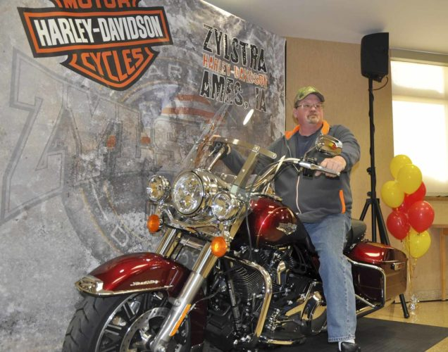 -Messenger photo by Joe Sutter  Arthur Clubb gets a feel for the new Harley-Davidson he won by being selected Decker Grand Champion Driver of the Year at a company celebration Friday.