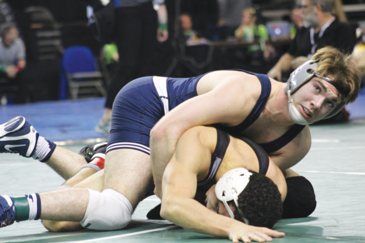 —Photo by Kirk Hardcastle  Iowa central's dayton racer competes in the 157 pound bracket at the NJCAA National Championships in Council Bluffs. Racer is in the semifinals.