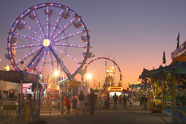 -File photo  The midwayis shown at night at the Clay County Fairground during its annual 10-day run.