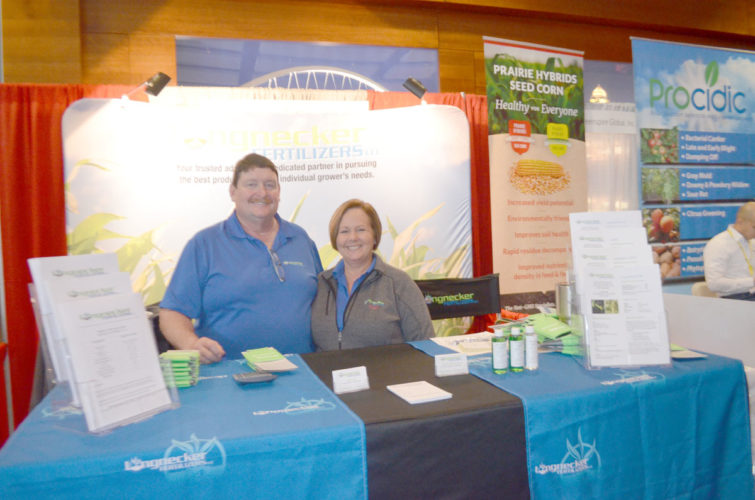 -Photo by  Larry Kershner  Jeff and Twila  Longneckers, pose for a photo behind their booth at the 2017 Iowa Power Farming Show in Des Moines. The family business recently launched out on its own providing fertilizer mixes to clients primarily throughout the Corn Belt.